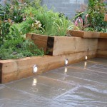 small-garden-lighting and raised beds