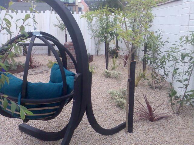 Small Garden Low Maintenance Pebble Garden And Swing Seat Peter