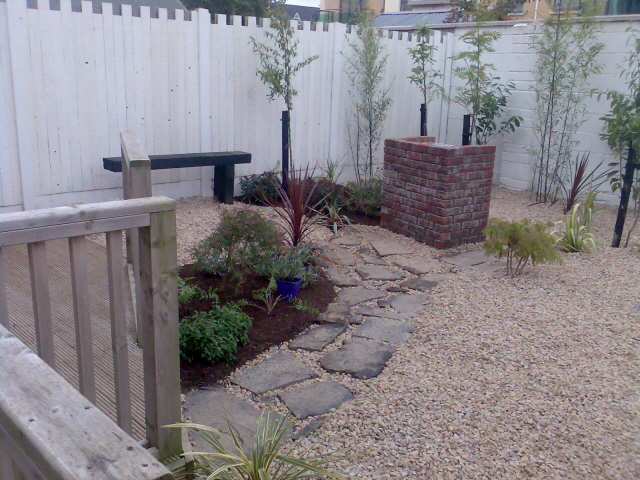 Small garden pebble garden low maintenance peter donegan for Easy care landscape design