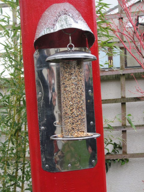 The Red Exhaust Pipe Bird Feeder Peter Donegan
